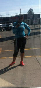 Posing in a store window after the run